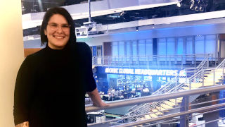 Ashley Turner standing in a news studio