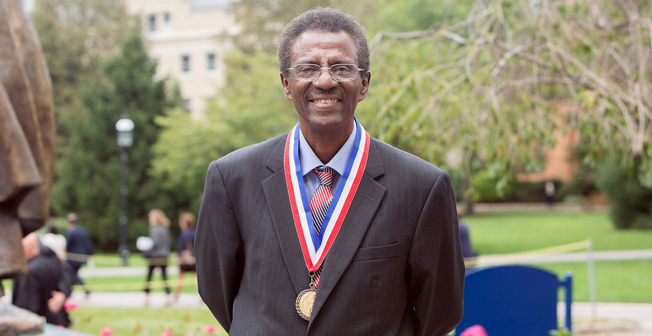 Professor Assefaw Bariagaber, Ph.D. wearing the Albert B. Hakim Faculty Service Medal.