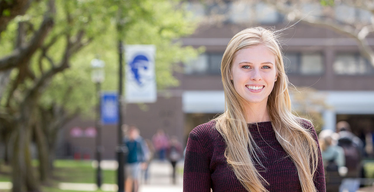 Diplomacy Student, Emma Tobin, standing on the Seton Hall campus.