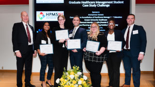 Group photo of students at the Graduate Healthcare Management Case Study Challenge