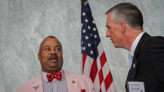 Image of Donald Payne speaking with a constituent