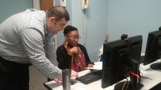 Instructional Designer, Riad Twal assisting a faculty member in Space 154.