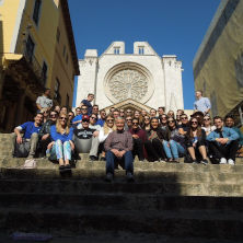 Business Students sitting on steps in Spain.