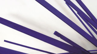 Diagonal purple lines on a white background
